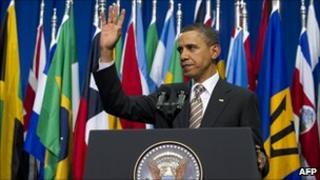 US President Barack Obama waving after speaking in Santiago