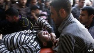 An injured Palestinian man is wheeled into the al-Shifa hospital in Gaza City following an Israeli military strike in Gaza City on March 22, 2011