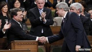 Finance Minister Jim Flaherty (left) shakes hands with Canadian Prime Minister Stephen Harper (right)