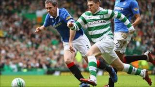 Gary Hooper of Celtic and David Weir of Rangers