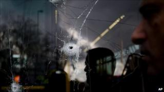 Holes on a bus window after an explosion in Jerusalem (23 March 2011)