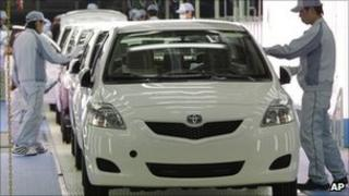 Workers give the final check toyota cars