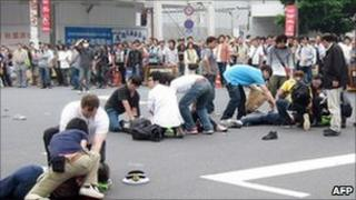 June 8, 2008 injured victims stabbed by Tomohiro Kato lying in street, Tokyo