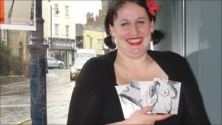 Curator Sarah Banville