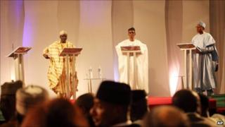Ibrahim Shekarau, left, Nuhu Ribadu, centre, Gen Muhammadu Buhari, right, and an empty podium at far left for President Goodluck Jonathan, attend a presidential debate in Abuja, Nigeria, Friday March 18, 2011.