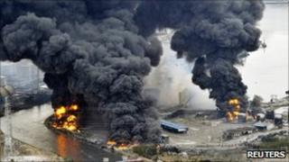 A factory facility burns following an earthquake and tsunami in Sendai