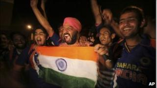 Indian fans celebrate the victory of their team over Australia in the ICC Cricket World Cup quarter-final match, in Kolkata, India, Thursday, March 24, 2011