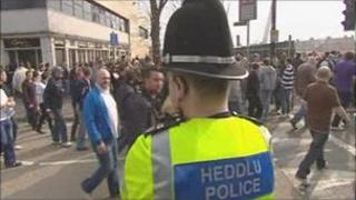 Police officer and football fans