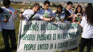 Greek and Turkish Cypriot teenagers jointly commemorating the victims of bloodshed on the island.