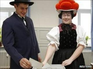 A German couple in traditional Black Forest costumes votes in Baden-Wuerttemberg. Photo: 27 March 2011