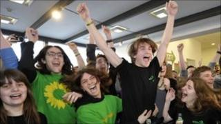 Green party supporters celebrate the exit polls in Stuttgart, 27 March
