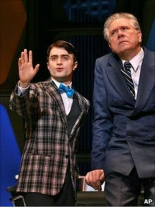 Daniel Radcliffe and John Larroquette in How to Succeed in Business Without Even Trying
