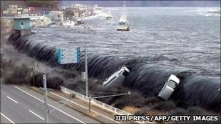 Tsunami sweeps inland in Japan (Photo: Jiji Press/AFP/Getty Images)