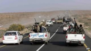 Libyan rebel vehicles pack the road between Ras Lanuf and Sirte, 28 March