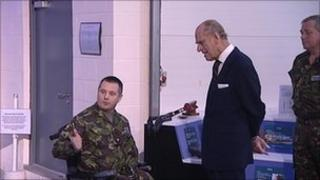The Duke of Edinburgh meets Major Peter Norton at the Defence Academy in Shrivenham