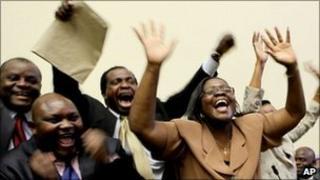 Zimbabwe's Movement for Democratic Change members of parliament celebrate the victory of Lovemore Moyo, who won the most votes in an election to determine the next speaker of the country's parliament
