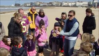 Project officer Suzie Hooper with people on the beach