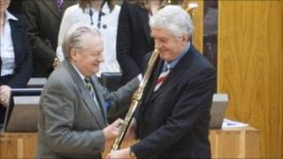 Presiding Officer Dafydd Elis Thomas gives Rhodri Morgan the mace