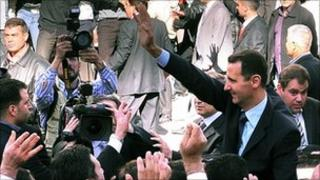 President Bashar al-Assad waving to supporters in Damascus, 30 March 2011, AFP PHOTO / HO / SANA