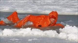 Prince Harry swims in icy water on the island of Spitzbergen