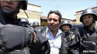 Drug suspect Juan Ortiz Lopez is escorted by police in Guatemala