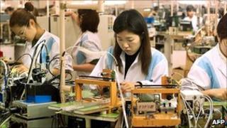 Workers assembling parts at Sony factory