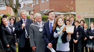 John Pennington (Chair of Governors), Alan Banks (Mayor of Cheadle), Stephen Bell (Head of College) and Emily Shore (Anne Frank Trust) admire the sapling at Painsley College