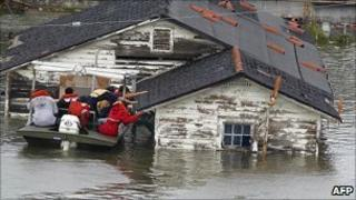A man is rescued from his home in a flooded section of New Orleans