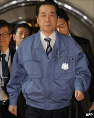 Prime Minister Naoto Kan arrives at parliament on 30 March 2011