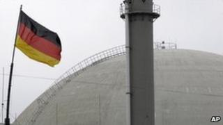German flag waves at the nuclear power plant of Biblis, Germany
