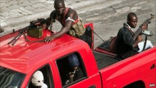 Pro-Gbagbo militiamen patrol Abidjan, Ivory Coast - 31 March 2011