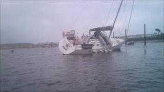Boat on its side at Pwllheli harbour