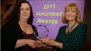 Brenda Robinson receives her award from Dr Dawn Cranswick