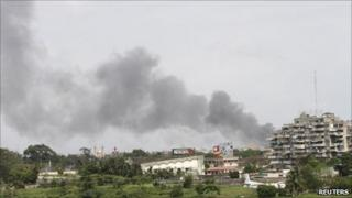 Smoke rises from the city centre of Abidjan 1 April 2011