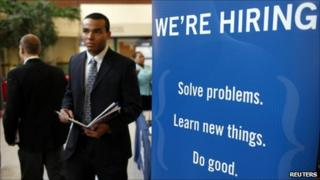 A job seeker walks the floor at a large career fare at Rutgers University in New Brunswick, New Jersey