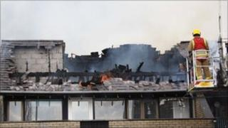 Fire burns through building
