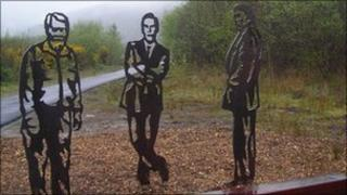 Park ranger Dick Wagstaff, comedian Rob Brydon and actor Richard Burton on a similar bench in South Wales