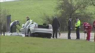 Police inspect crashed vehicle