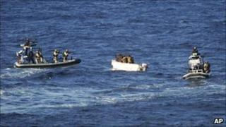 Dutch marines on board of two Dutch navy motorboats capture suspected pirates in a small skiff off the coast of Somalia, April 3. 2011