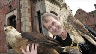 Frank Caldwell shows off two birds on guard at Haden Hill House