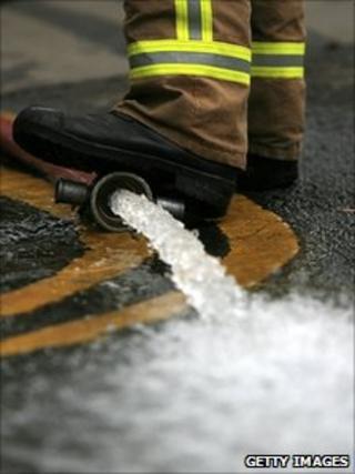 Fire hose pumps flood water