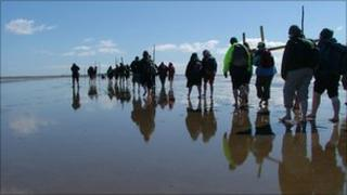 Pilgrims crossing the tidal causeway to Lindisfarne on Good Friday 2006. Photo: NorthernCross www.northerncross.co.uk