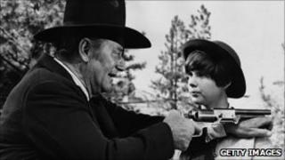 John Wayne with Kim Darby in True Grit