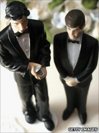 Same sex statues adorn the top of a wedding cake