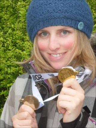 Kate Foster displays her two medals