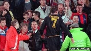Eric Cantona walks off the pitch before confrontation with Matthew Simmons in 1995