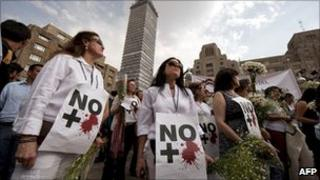 """Protesters in Mexico City with signs reading """"No More Blood"""" during demonstrations in April"""