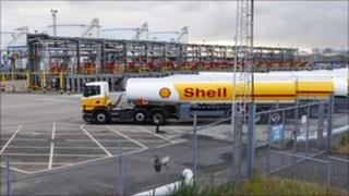 Petrol tankers lined up outside the Stanlow oil refinery in Cheshire