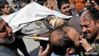 People carry Moulvi Showkat Shah's body in Srinagar on 8 April 2011