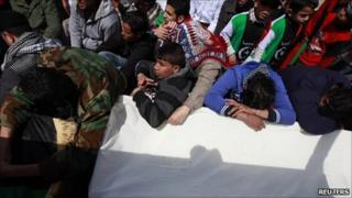 Mourners pray over the coffin of a man killed in the Nato air strike.